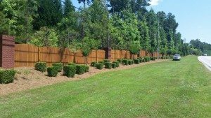 Scalloped Wood Fence Brick Columns